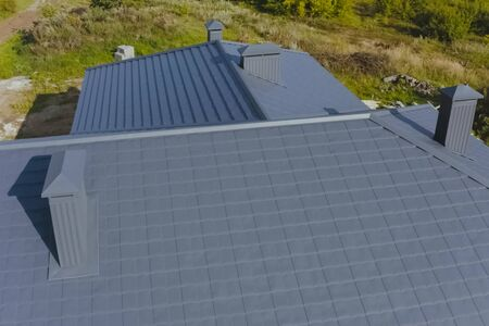 Modern roof made of metal. Corrugated metal roof and metal roofing. Фото со стока