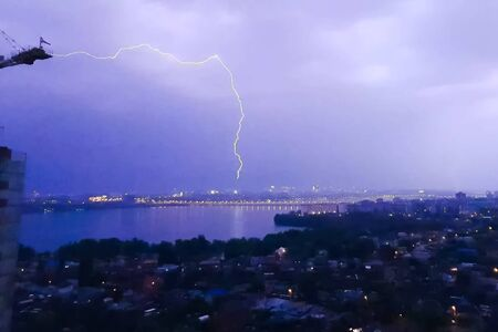 Lightning during a thunderstorm in the sky. Natural phenomenon of electricity, lightning.