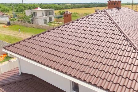 Modern roof made of metal. Corrugated metal roof and metal roofing. Reklamní fotografie