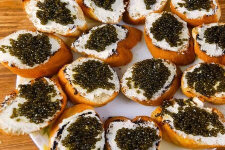 Sandwiches from a loaf with black caviar. Dear black caviar. Zdjęcie Seryjne