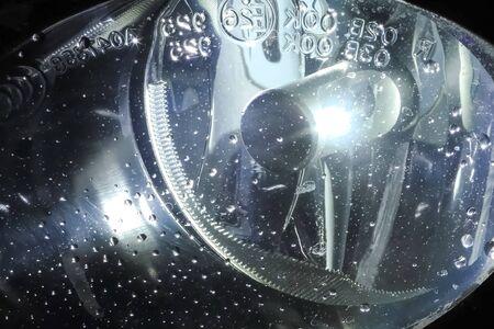 The xenon lamp in the cars headlight glows.