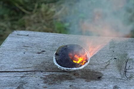 Burning chemical in the cup. Burning chemical