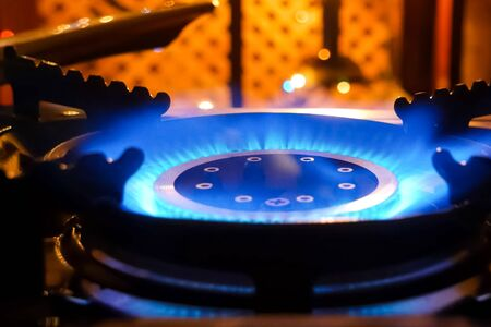 Burning gas stove. Blue flame of a gas burner.