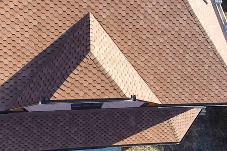 House with a roof from a bituminous tile. Bituminous tile for a roof. a roof from a bituminous tile. Stockfoto