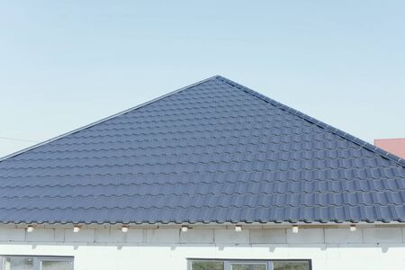 Modern roof made of metal. Corrugated metal roof and metal roofing.