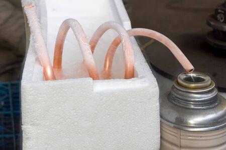 Liquid air, pouring liquefied air into .