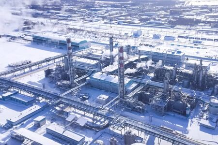 Oil refinery and petrochemical plant in winter.