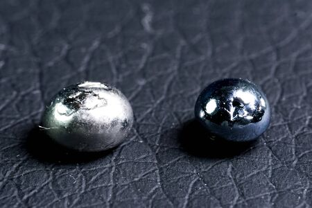 Osmium, metal pieces for sample. The heaviest metal is osmium.