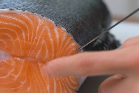 a Butchering salmon, piece of salmon red fish meat.