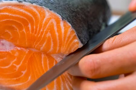 a Butchering salmon, piece of salmon red fish meat. Archivio Fotografico
