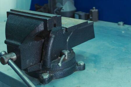 Vise on a workbench. Equipment locksmith workshop. equipment for a locksmith. Stock fotó
