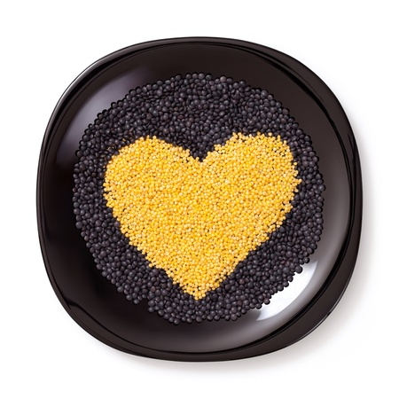 yellow heart: Heart shaped Cereals isolated on white background.