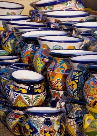 Stacks of Colorful Mexican Pottery at Sunset