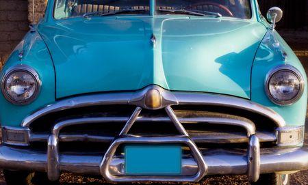 Classic car restoration detail in sunset. Nice Chrome bumper.