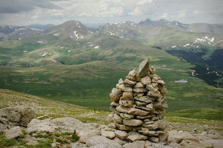 Mountain Summit Hiking Summer Rain Storm. Colorado Summer Mountain Backcountry Scene. Great for themes of nature, summer, mountains, outdoor rereation, travel destinations, background scenics. photo