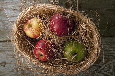 Apples in the wicker basket photo