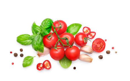 Ingredients for cooking, garlic, tomatoes, spices and herbs isolated on white background. Top view.