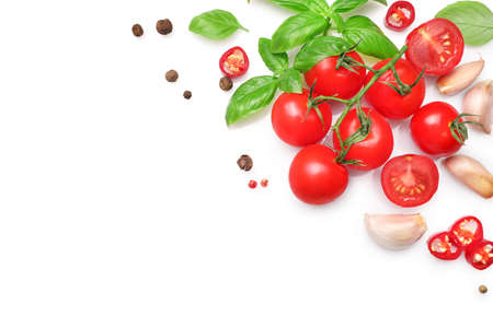 Ingredients for cooking, garlic, tomatoes, spices and herbs isolated on white background. Top view. Copy space.