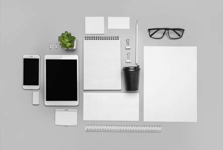 Corporate identity stationery set on gray background. Top view. Imagens