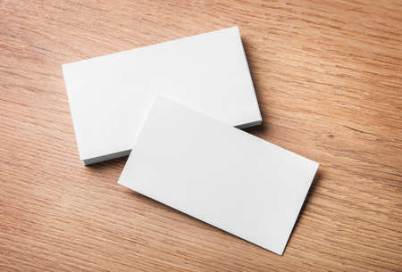 Blank business cards on wooden background. Top view. Banque d'images