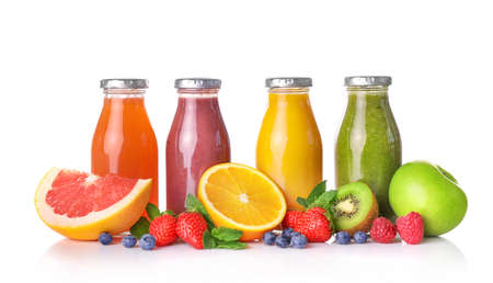 Set of fruit juices in glass bottles isolated on white background.