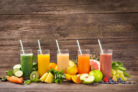 Set of fruit juices in glasses on wooden background. Copy space. Banque d'images