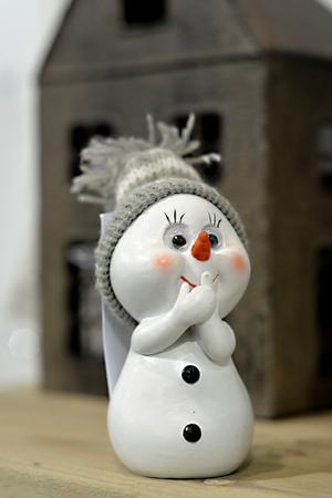 Little snowman with white cap 版權商用圖片