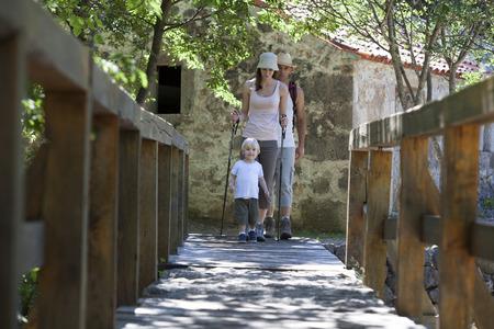 Croatia, Paklenica, Family with one child enters a bridge