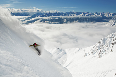 conquering adversity: Snowboarder takes a powder turn, Innsbruck, Austria LANG_EVOIMAGES