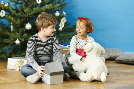 Children playing with stuffed toy on Christmas Eve, Munich, Bavaria, Germany LANG_EVOIMAGES