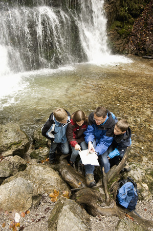 Family Looking At Map, Bavaria, Germany, Europe