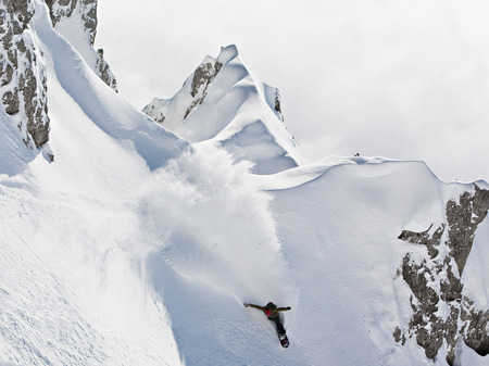 Snowboarder speeding downhill, Innsbruck, Tyrol, Austria