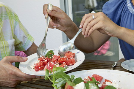Couple Eating Melon Salad