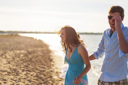 Young couple on the beach, laughing, Dalmatia, Croatia
