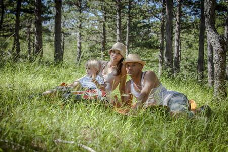Croatia, Paklenica, Family with one child takes a rest in a meadow