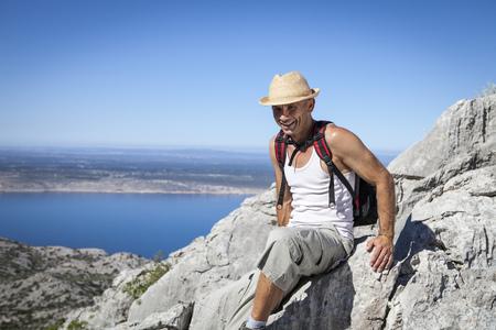 Croatia, Paklenica, Male hiker in mountain scenery