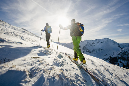 skiers: Backcountry skiers on the move, with back light, Alpbachtal, Tyrol, Austria, Europe