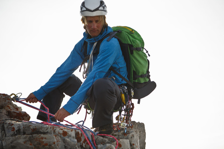 rappel: Alpinist climbing in mountains, about to rappel, Stubai, Kalkkoegel, Austria LANG_EVOIMAGES