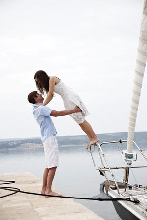 Croatia, Young couple in port having fun