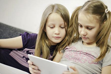 Two girls using digital tablet, Osijek, Croatia, Europe LANG_EVOIMAGES