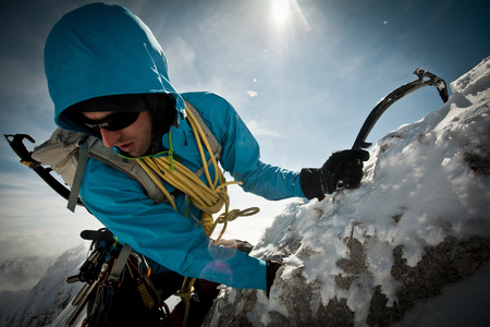 Alpinist on the rope, using ice axe, Zugspitze Mountain, Bavaria, Gerrmany