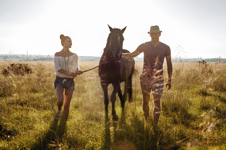 Croatia, Dalmatia, Young couple with horse in a meadow