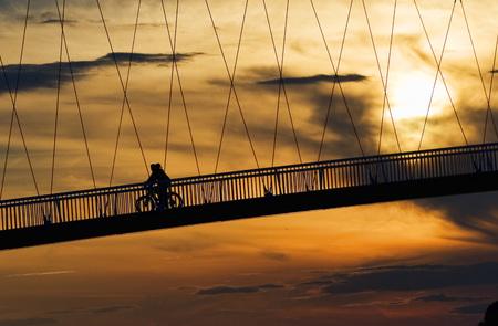 Pedestrian footbridge over Drava river at sunset, Osijek, Croatia
