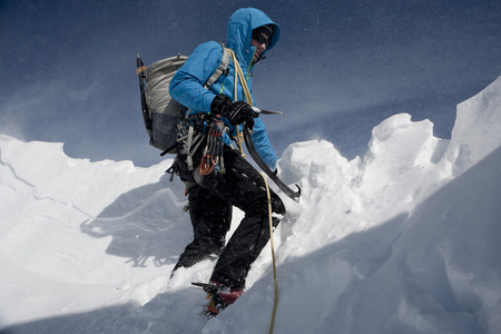 Alpinist on the rope, climbing down, Zugspitze Mountain, Bavaria, Germany