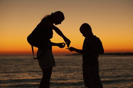 Mother And Sun On Beach, Croatia, Dalmatia, Europe