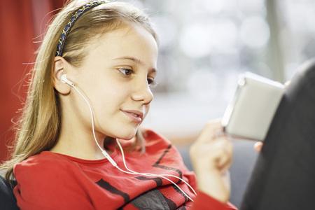 Girl listening to music, Osijek, Croatia, Europe