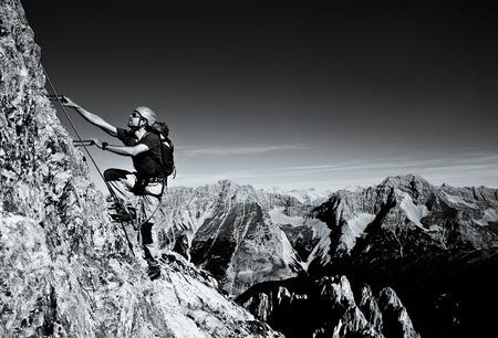 Alpinist rock climbing, Innsbruck route, Tyrol, Austria LANG_EVOIMAGES
