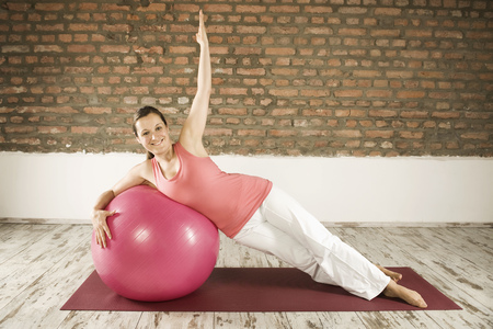 body consciousness: Woman Doing Pilates With Fitness Ball, Munich, Bavaria, Germany, Europe
