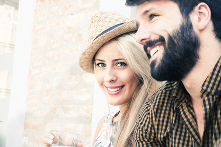 Portrait of happy young couple outdoors LANG_EVOIMAGES