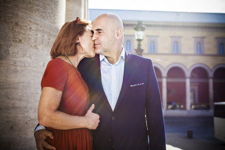 tenderly: Senior couple kissing tenderly, Munich, Bavaria, Germany LANG_EVOIMAGES